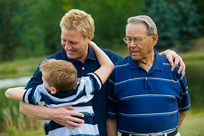 Who is a Caregiver? - Father, son, and grandson image