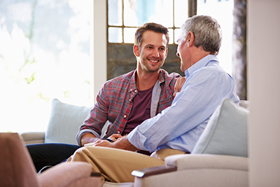 Working Caregivers Image - Man visiting his father in a group care home