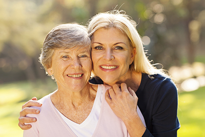 Aging Mastery Program Page - Woman caring for her aging mother